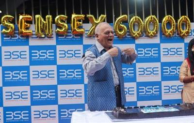 A man celebrates outside the the Bombay Stock Exchange (BSE), after Sensex surpassed the 60,000 level for the first time, in Mumbai, India, September 24, 2021. REUTERS/Francis Mascarenhas