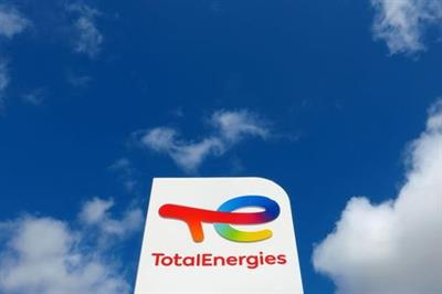 FILE PHOTO: The logo of French oil and gas company TotalEnergies is seen at a petrol station in Ressons, France, August 6, 2021. REUTERS/Pascal Rossignol/File Photo