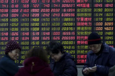 FILE PHOTO: Investors stand in front of an electronic board showing stock information on the first trading day after the week-long Lunar New Year holiday at a brokerage house in Shanghai, China, February 15, 2016. REUTERS/Aly Song//File Photo