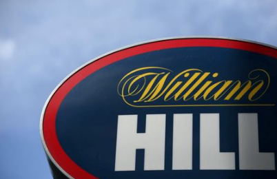 FILE PHOTO: A branded sign is displayed outside a William Hill betting shop in London, Britain July 25, 2016. REUTERS/Neil Hall/File Photo