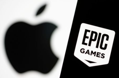 FILE PHOTO: Smartphone with Epic Games logo is seen in front of Apple logo in this illustration taken, May 2, 2021. REUTERS/Dado Ruvic/Illustration/File Photo