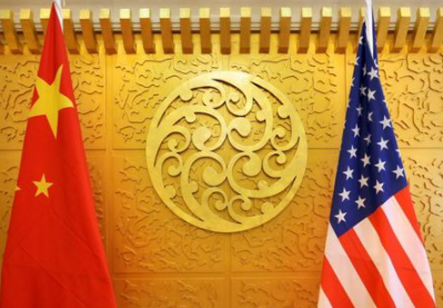 FILE PHOTO: Chinese and U.S. flags are set up for a meeting at China's Ministry of Transport in Beijing, China April 27, 2018. REUTERS/Jason Lee