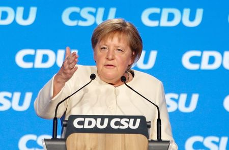 German Chancellor Angela Merkel speaks during a rally ahead of the general election, in Munich, Germany, September 24, 2021. REUTERS/Michaela Rehle