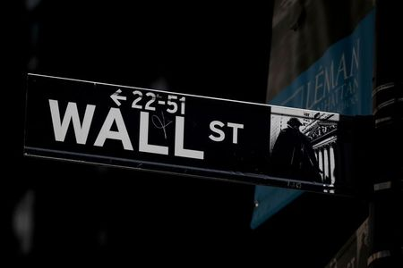 FILE PHOTO: A Wall St. street sign is seen near the New York Stock Exchange (NYSE) in New York City, U.S., September 17, 2019. REUTERS/Brendan McDermid/File Photo