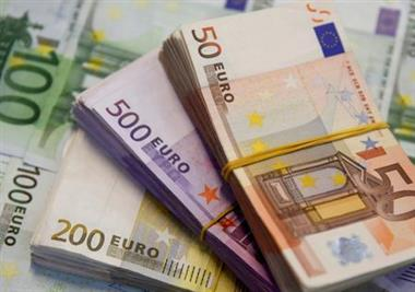 FILE PHOTO: A picture illustration shows Euro banknotes in Zenica, January 26, 2015. REUTERS/Dado Ruvic/File Photo