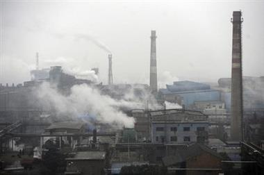 Smoke billows from a coking factory in Hefei, Anhui province March 2, 2012. Pollution by particulate matter smaller than 2.5 micrometers in diameter (PM2.5) has been a hot topic on the Internet for months and is now set to be a hot topic at China's upcoming annual sessions of the National People's Congress (NPC) and the Chinese People's Political Consultative Congress (CPPCC) National Committee, Xinhua News Agency reported. REUTERS/Stringer (CHINA - Tags: ENVIRONMENT)
