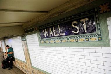A person waits on the Wall Street subway platform in the Financial District of Manhattan, New York City, U.S., August 20, 2021. REUTERS/Andrew Kelly