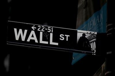 A Wall St. street sign is seen near the New York Stock Exchange (NYSE) in New York City, U.S., September 17, 2019. REUTERS/Brendan McDermid