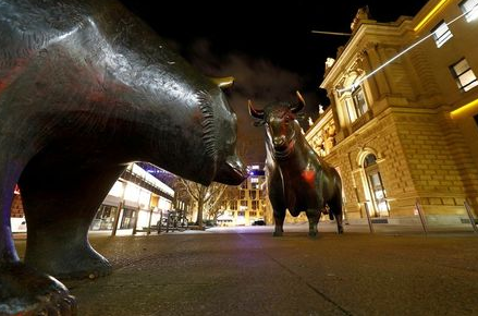 FILE PHOTO: Bull and bear symbols in front of the German stock exchange (Deutsche Boerse) in Frankfurt, Germany, February 12, 2019. REUTERS/Kai Pfaffenbach