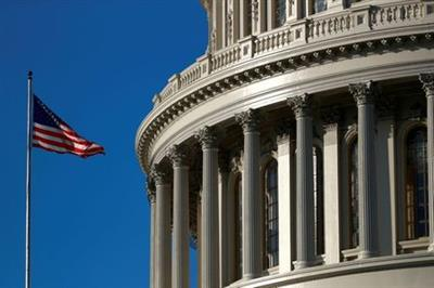 FILE PHOTO: An American flag flies outside of the U.S. Capitol dome in Washington, U.S., January 15, 2020. REUTERS/Tom Brenner/File Photo