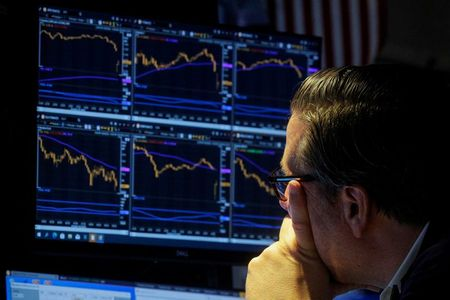 A specialist trader works inside a booth on the floor of the New York Stock Exchange (NYSE) in New York City, U.S., October 6, 2021. REUTERS/Brendan McDermid
