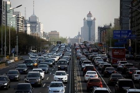Cars are seen in a traffic jam during evening rush hour in Beijing, as the country is hit by an outbreak of the novel coronavirus disease (COVID-19), China April 8, 2020. REUTERS/Tingshu Wang