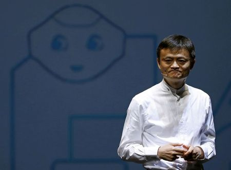 FILE PHOTO: Jack Ma, founder and executive chairman of China's Alibaba Group, speaks in front of a picture of SoftBank's human-like robot named 'pepper' during a news conference in Chiba, Japan, June 18, 2015. REUTERS/Yuya Shino