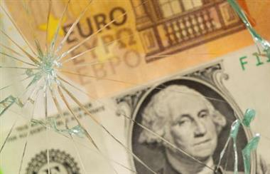 U.S. dollar and euro banknotes are seen through broken glass in this illustration taken, June 25, 2021. REUTERS/Dado Ruvic/Illustration