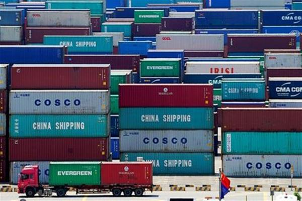 Containers are seen at the Yangshan Deep Water Port in Shanghai, China August 6, 2019. REUTERS/Aly Song