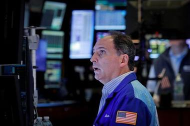 A trader works on the floor of the New York Stock Exchange (NYSE) in New York City, U.S., October 13, 2021. REUTERS/Brendan McDermid