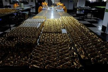 Scaled-down replicas of 2018 FIFA World Cup trophy, made of zinc alloy, are under production at a factory which manufactures official licensed products in Dongguan, China May 8, 2018. Picture taken May 8, 2018. REUTERS/Bobby Yip