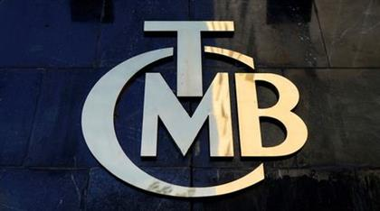 FILE PHOTO: A logo of Turkey's Central Bank (TCMB) is pictured at the entrance of the bank's headquarters in Ankara, Turkey April 19, 2015. REUTERS/Umit Bektas/File Photo