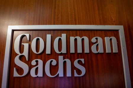 FILE PHOTO: The Goldman Sachs company logo is seen in the company's space on the floor of the New York Stock Exchange, (NYSE) in New York, U.S., April 17, 2018. REUTERS/Brendan McDermid/File Photo/File Photo