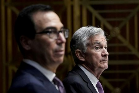 U.S. Treasury Secretary Steven Mnuchin and Federal Reserve Board Chairman Jerome Powell testify during a Senate's Committee on Banking, Housing, and Urban Affairs hearing examining the quarterly CARES Act report to Congress, in Washington, DC, U.S., September 24, 2020. Drew Angerer/Pool