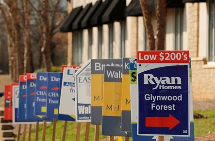 Real estate signs advertise new homes for sale in multiple new developments in York County, South Carolina, U.S., February 29, 2020. REUTERS/Lucas Jackson