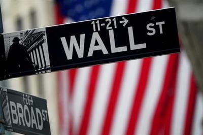 A Wall Street sign outside the New York Stock Exchange in New York City, New York, U.S., October 2, 2020. REUTERS/Carlo Allegri