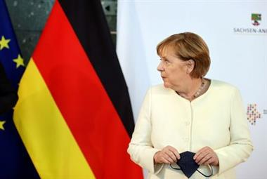 FILE PHOTO: Outgoing German Chancellor Angela Merkel holds a protective face mask as she attends a ceremony to mark the 31st anniversary of Germany's Unification Day, in the city of Halle, Germany, October 3, 2021. Jan Woitas/Pool via REUTERS/File Photo