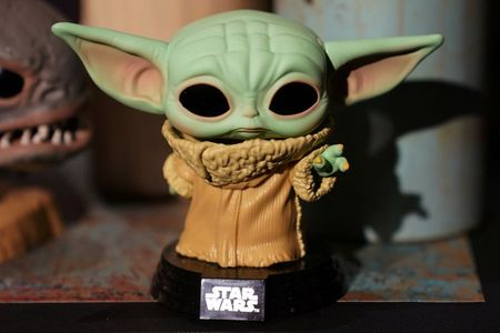 """A Baby Yoda toy is pictured during a """"Star Wars"""" advance product showcase in the Manhattan borough of New York City, New York, U.S., February 20, 2020. REUTERS/Carlo Allegri"""