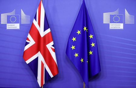 Flags of the Union Jack and European Union are seen ahead of the meeting of European Commission President Ursula von der Leyen and British Prime Minister Boris Johnson, in Brussels, Belgium December 9, 2020. Olivier Hoslet/Pool via REUTERS