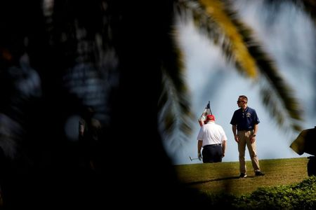 U.S. President Donald Trump plays golf at the Trump International Golf Club in West Palm Beach, Florida, U.S., December 27, 2020. REUTERS/Marco Bello REFILE - CORRECTING CLUB NAME