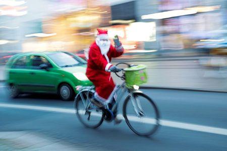A person dressed as Santa Claus rides a bike, amid the coronavirus disease (COVID-19) outbreak in Dresden, Germany, December 12, 2020. REUTERS/Hannibal Hanschke