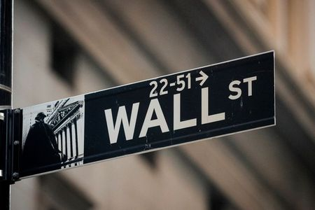 A Wall St. sign is seen near the New York Stock Exchange (NYSE) in the financial district in New York, U.S., November 24, 2020. REUTERS/Brendan McDermid