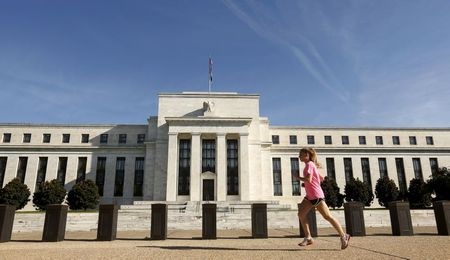 A woman jogs past the Federal Reserve headquarters in Washington September 16, 2015. The Federal Reserve, facing this week its biggest policy decision yet under Chair Janet Yellen, puts its credibility on the line regardless of whether it waits or raises interest rates for the first time in nearly a decade. REUTERS/Kevin Lamarque