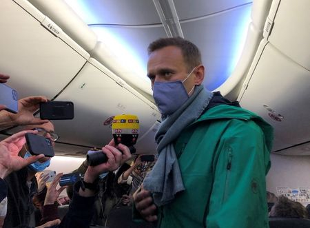 Russian opposition leader Alexei Navalny is seen on board a plane before the departure for the Russian capital Moscow at an airport in Berlin, Germany January 17, 2021. REUTERS/Polina Ivanova