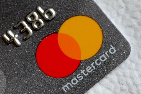 A Mastercard logo is seen on a credit card in this picture illustration August 30, 2017. REUTERS/Thomas White/Illustration