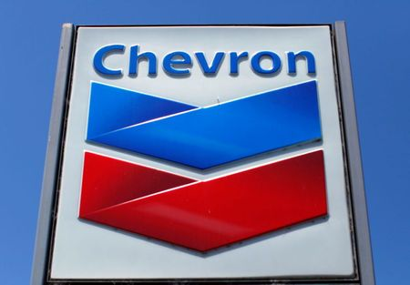 A Chevron gas station sign is seen in Del Mar, California, April 25, 2013. Chevron will report earnings on April 26. REUTERS/Mike Blake