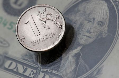A view shows a Russian rouble coin and a U.S. dollar banknote in this picture illustration taken October 26, 2018. Picture taken October 26, 2018. REUTERS/Maxim Shemetov