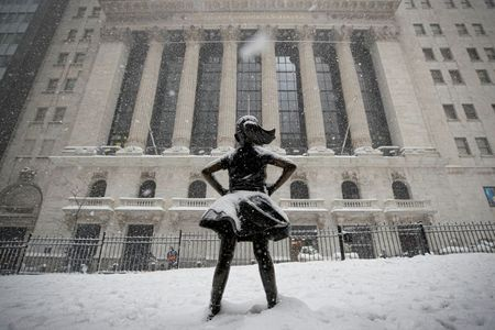 "The ""Fearless Girl"" sculpture is seen outside the New York Stock Exchange (NYSE) during a snow storm in the Manhattan borough of New York City, New York, U.S., February 1, 2021. REUTERS/Brendan McDermid"