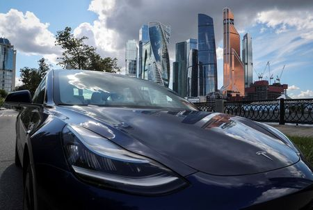 FILE PHOTO: A Tesla Model 3 electric vehicle is shown in this picture illustration taken in Moscow, Russia July 23, 2020. REUTERS/Evgenia Novozhenina/File Photo
