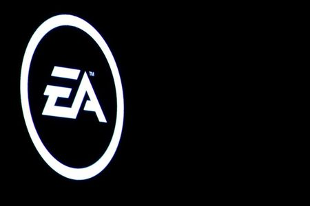 FILE PHOTO: The Electronic Arts Inc., logo is displayed on a screen during a PlayStation 4 Pro launch event in New York City, U.S., September 7, 2016. REUTERS/Brendan McDermid