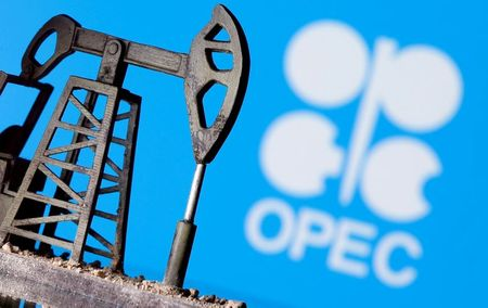 FILE PHOTO: A 3D printed oil pump jack is seen in front of displayed OPEC logo in this illustration picture, April 14, 2020. REUTERS/Dado Ruvic/File Photo