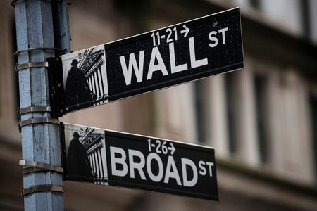 The Wall St. and Broad St. signs are seen outside The New York Stock Exchange (NYSE) in New York, U.S., February 16, 2021. REUTERS/Brendan McDermid