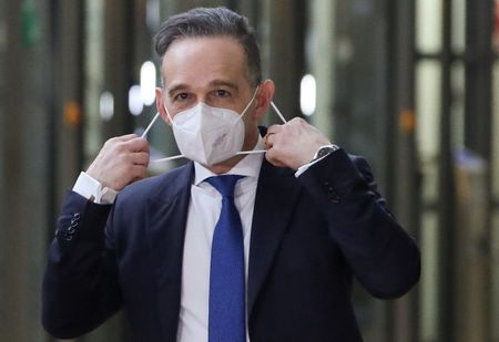 German Foreign Minister Heiko Maas adjusts his mask as he arrives to attend an EU Foreign Ministers meeting in Brussels, Belgium February 22, 2021. REUTERS/Yves Herman/Pool - RC2KXL9LBC3X