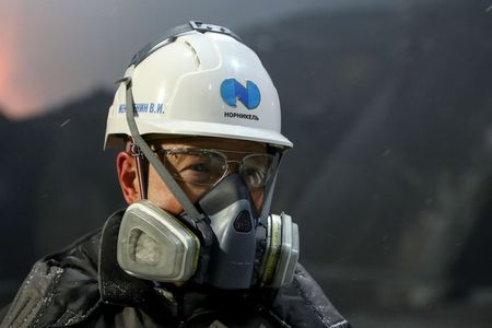 An employee wears a safety helmet at a metallurgical workshop of Kola Mining and Metallurgical Company (Kola MMC), a subsidiary of Nornickel metals and mining company, in the town of Monchegorsk in Murmansk Region, Russia February 25, 2021. REUTERS/Evgenia Novozhenina