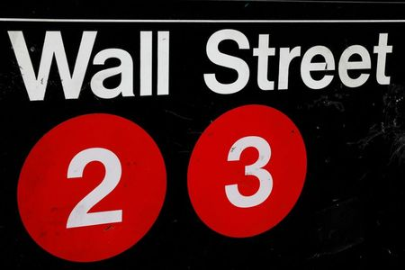 FILE PHOTO: A sign for the Wall Street subway station is seen in the financial district in New York City, U.S., August 23, 2018. REUTERS/Brendan McDermid/File Photo