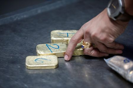 Gold bars are seen before the refining process at AGR (African Gold Refinery) in Entebbe, Uganda, October 4, 2018. Picture taken October 4, 2018. To match Insight AFRICA-GOLD/REFINERIES REUTERS/Baz Ratner