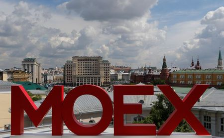 The letters MOEX are pictured at the Moscow Exchange, with the Kremlin and the Four Seasons Hotel seen in the background, in Moscow, Russia, May 26, 2017. Picture taken 26, 2017. REUTERS/Segrei Karpukhin