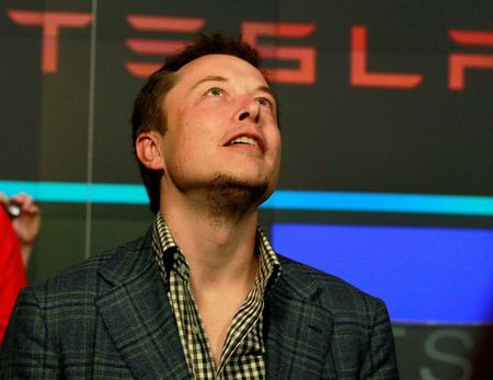 CEO of Tesla Motors Elon Musk reacts following the company's initial public offering at the NASDAQ market in New York June 29, 2010. REUTERS/Brendan McDermid