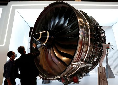 FILE PHOTO: People look at Rolls Royce's Trent Engine displayed at the Singapore Airshow in Singapore February 11, 2020. REUTERS/Edgar Su/File Photo