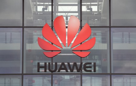 FILE PHOTO: Huawei logo is pictured on the headquarters building in Reading, Britain July 14, 2020. REUTERS/Matthew Childs/File Photo